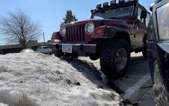Trevor Buckingham's Jeep TJ tackles snow piles in PCM parking lot.