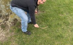 PCM senior Dylan Warrick participates in community service day by picking up sticks.