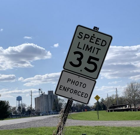 "Various speed limit signs in town have had new ""photo enforced"" signs placed under them to emphasize the new speeding regulations."