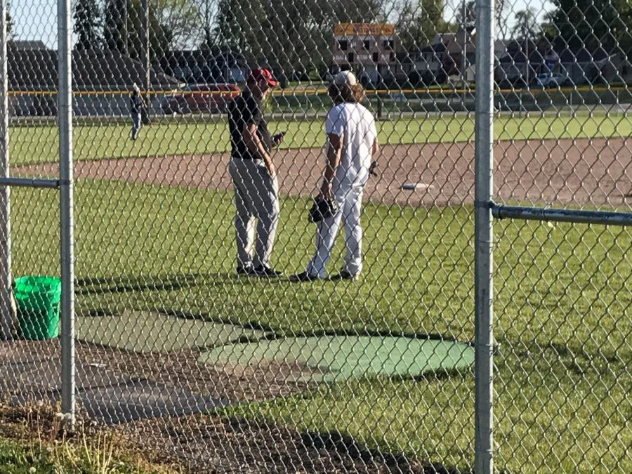 PCM senior Caleb Duinink (right) talks with head coach Jeff Lindsay (right) at baseball practice. Duinink will start at catcher for his final season after starting throughout his high school career. Lindsay is always getting him to improve. The 2021 season will start on Monday, May 24, against Pella at Pella High School.